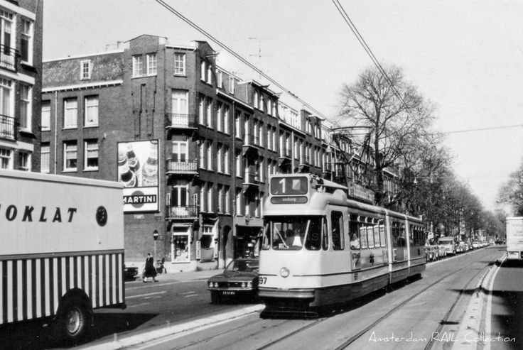 1972. A view of the Overtoom with tram line 1 in Amsterdam-West. The Overtoom is a street that connects the Stadhouderskade and the Amstelveenseweg. In the 1800's the street was a canal that, after the construction of the Jacob van Lennepkade, was filled-in in 1904, making it a wide exit route originating from the Leidseplein to the Amstelveenseweg. Photo Amsterdam Rail Collection. #amsterdam #1972 #Overtoom