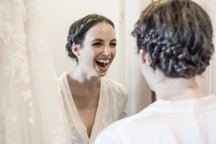 Happy bride in her beautiful makeup and hair by Dora Graff.
