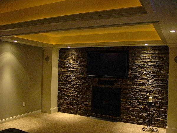 Stone accent wall is a classy easy diy remodel. takes a couple of 4x8 panels screwed into the wall . you can shape it around things or hang things from it bc the faux stone is light weight