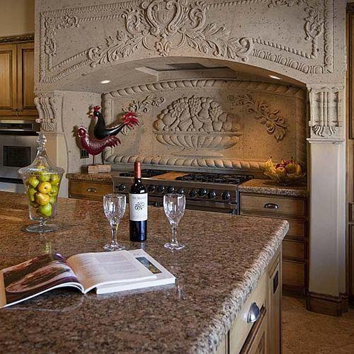 Custom hand carved kitchen range hood hands