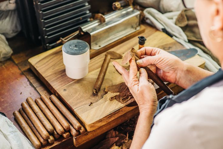 Cigar Makers hand rolling each cigar in front of you in Ybor City
