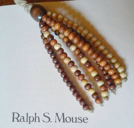 Check out this item in my Etsy shop https://www.etsy.com/listing/270803592/custom-bookmarks-tassles-and-beads-hemp
