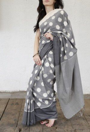 Image from http://ak0.scstatic.net/1/cdn2-cont6.sweetcouch.com/143662043072800455-grey-polka-cotton-saree.jpg.