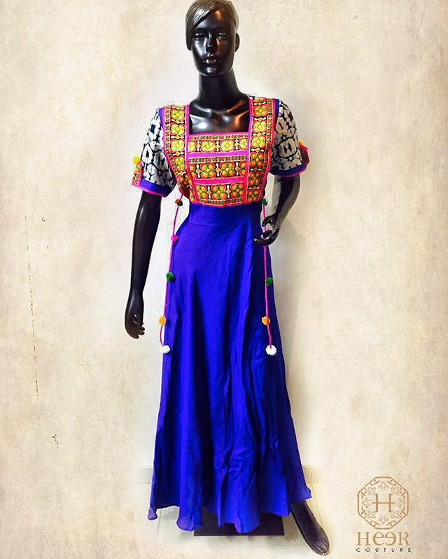 Exquisite Santoon Silk gown with traditional Gamthi embroidery on the yoke . The oscillating tassels hanging around the obliques gives a bohemian touch to the outfit . #santoon #silk #gown #gamthi #embroidery #tassel #bohemian #chic #elegant #modish #ootd #fashion #style #girl #women #couture #designergown #bohochic #bohogirl #mumbai #india #traditional #desi #navratri #ethnic #beautiful #love #friends #bff