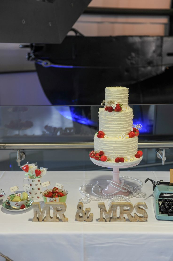 Cake in front of X24, a 1940s era midget submarine, from a recent photo-shoot with Alisha's events photography