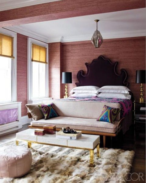 In the master bedroom of Jackie Astier's Manhattan apartment, the custom-made headboard is upholstered in an Osborne & Little velvet.