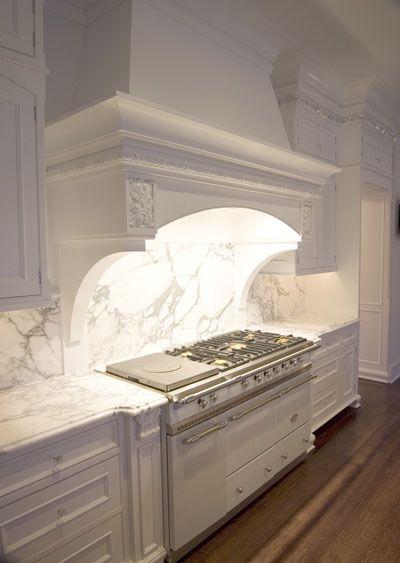 Stunning kitchen design with Calacatta Marble countertops and seamless backsplash.