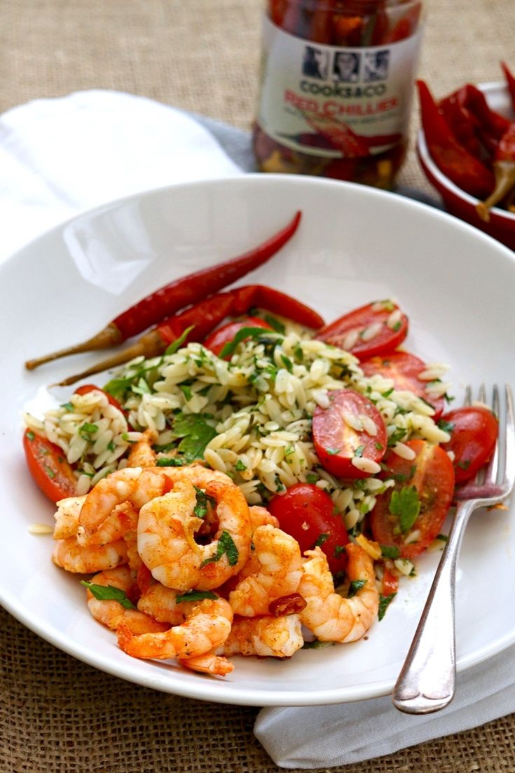 This vibrant chilli prawn recipe is the perfect midweek meal: quick, simple and absolutely delicious. The prawns are cooking in warming chilli butter and served with a pasta and tomato salad.