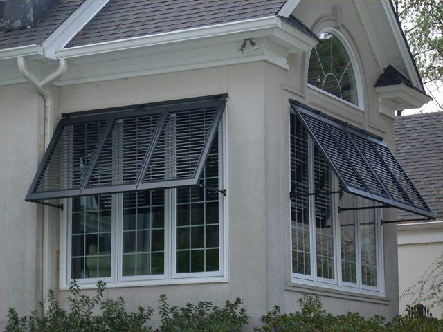 Or bahama shutters for the front windows in white window for Bahama shutter plans