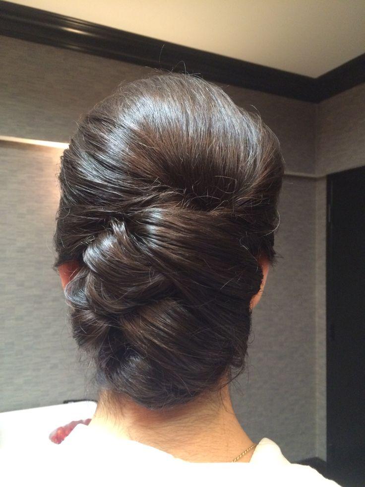 Sleek, elegant bridal updo. Bun with volume