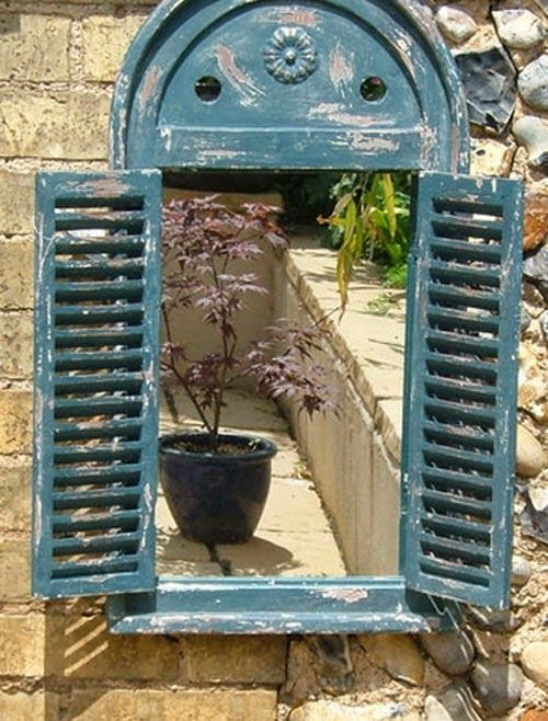 Love the idea of a window frame round a mirror in garden