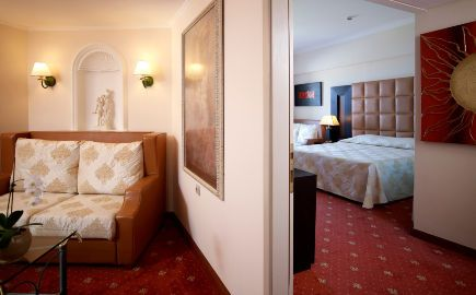 Junior Suite features a bedroom and a separate living room with a large sofa bed