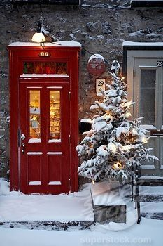 SuperStock - Canada, Quebec Province, Quebec City, Old Town listed World Heritage by UNESCO, Petit Champlain Street, red door and decorated Christmas tree