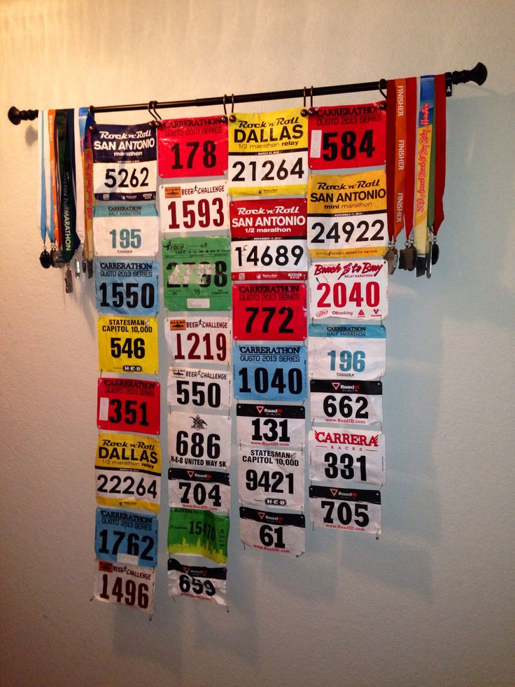 DIY medal display! Hubby's is the left half, mine is the right half. Running Reyna's!!!