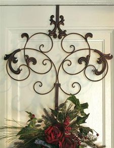 Ornate Chirstmas Wreath Door Hanger  Ornate stately metal door wreath hanger. 18.5''H x 19.25''W x 4.25''D. Very beautiful. Item WR25003. If you want to include this with a wreath we will refund your shipping.