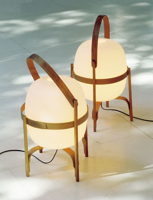 The Cesta floor lamp, design by Miguel Mila for Santa & Cole.  Cherry wood and glass