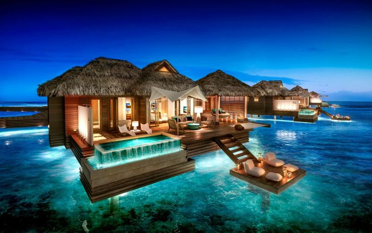 The new overwater bungalow villa suites at the Sandals Royal Caribbean in Jamaica.  These are amazing suites for any type of romantic getaway...a destination wedding, a honeymoon, anniversary or vow renewal.  These overwater suites are the types of rooms you can only dream about until now.  check out my article on these new rooms from Sandals resorts.  #honeymoon destinations, #destination wedding locations, #vow renewal, #anniversary trips