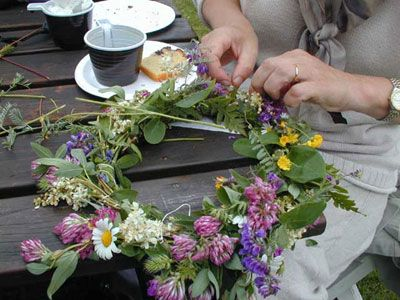 A Midsummer wreath! All the girls (and some boys) wear one on Midsummer in Sweden.    Midsommarkrans!