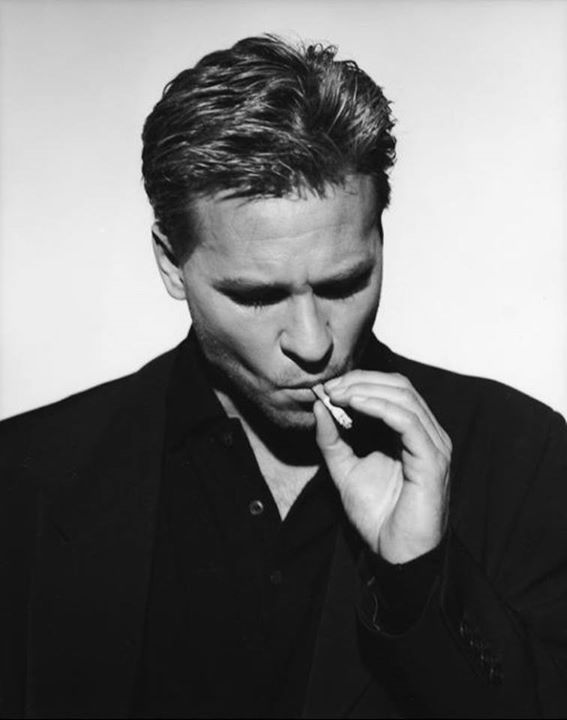 Val Kilmer is the actor who played one of my all time favorite characters in cinema... Doc Holiday in Tombstone. Some people love this movies others think it's just alright (I adore it). He's also had roles in the movies Heat and Top Gun.