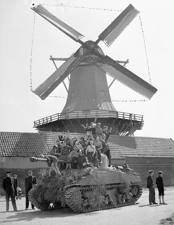 Dutch children riding on a Sherman tank of Lord Strathcona's Horse (Royal Canadians), Harderwijk, Netherlands, April 19th 1945.