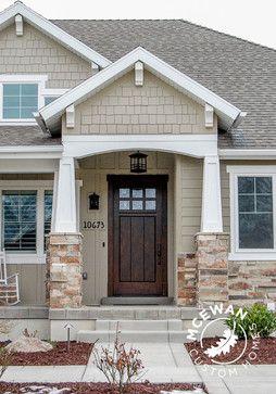 Custom wood front door l McEwan Custom Homes #mcewancustomhomes #smalldetailsbigdifference #frontdoor #columns #stone #boardandbatten #utah #utahhomesales