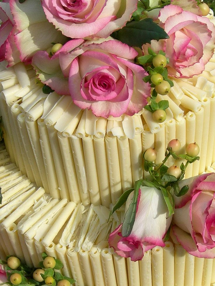 Chocolate wedding cake with Belgian chocolate curls and fresh summer flowers.