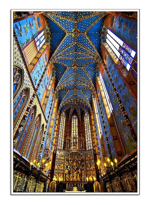 Krakow, Lesser Poland - This is the interior of the beautifully ornate St. Mary's Basilica in Kraków. Which was re-built in the 14th century, originally built in the 13th century. The Basilica which is a Brick Gothic Church is extremely tall and stands at 80 meters (262 feet) tall. The Basilica has been an architectural model for many churches built by the Polish abroad, #architecture #clickseo #marketing #onlinemarketing #design