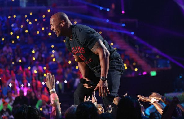 Dwayne Johnson Photos Photos - Actor Dwayne Johnson speaks onstage during Nickelodeon Kids' Choice Sports Awards 2014 at UCLA's Pauley Pavilion on July 17, 2014 in Los Angeles, California. - Nickelodeon Kids' Choice Sports Awards Show