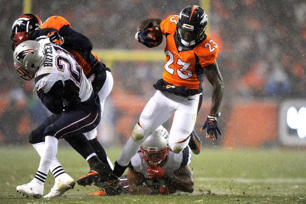 Running back Ronnie Hillman #23 of the Denver Broncos scores a second quarter touchdown past middle linebacker Jerod Mayo #51 of the New England Patriots at Sports Authority Field at Mile High on November 29, 2015 in Denver, Colorado.
