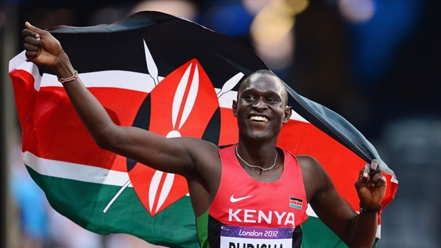 David Lekuta Rudisha of Kenya celebrates with his country's national flag after winning gold and setting a new world record of 1.40.91 in the Men's 800m Final on Day 13 of the London 2012 Olympic Games at Olympic Stadium