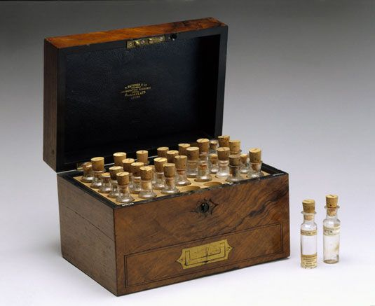 Walnut homeopathic medicine chest, with bottles, late 19th century.