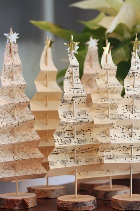 Use old maps and sheet music to create simple and elegant table-top Christmas trees. Great for place settings and small spaces.