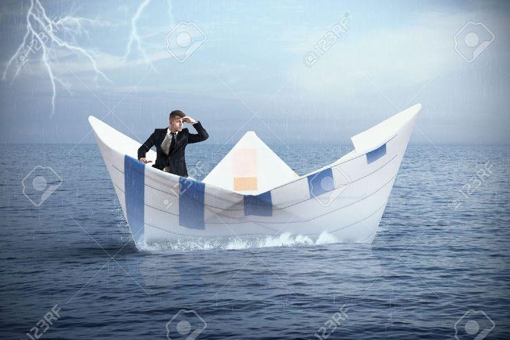 previews.123rf.com images alphaspirit alphaspirit1308 alphaspirit130800082 21509723-Businessman-escapes-from-the-crisis-on-a-paper-boat-Stock-Photo.jpg