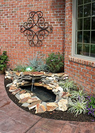 DIY BACKYARD POND & LANDSCAPE WATER FEATURE. Like the corner shelf planter....I would also do my front yard this way as well.