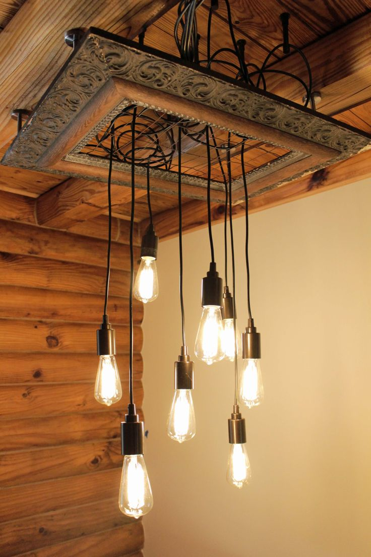 Designed by Company 87 Studios using a vintage Gesso frame and reclaimed wire fencing.