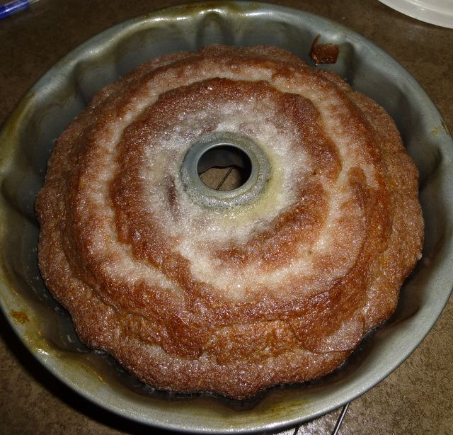 Crack Bundt Cake - 1 box yellow cake mix , 1/4 c brown sugar, 1/4 c white sugar  1 box vanilla pudding instant mix 2 tsp. cinnamon 4 eggs  3/4 c water 3/4 c oil 1/2 c white wine (any kind) For the Glaze  1 stick (1/2 cup) melted butter  1 cup sugar 1/4 cup white wine