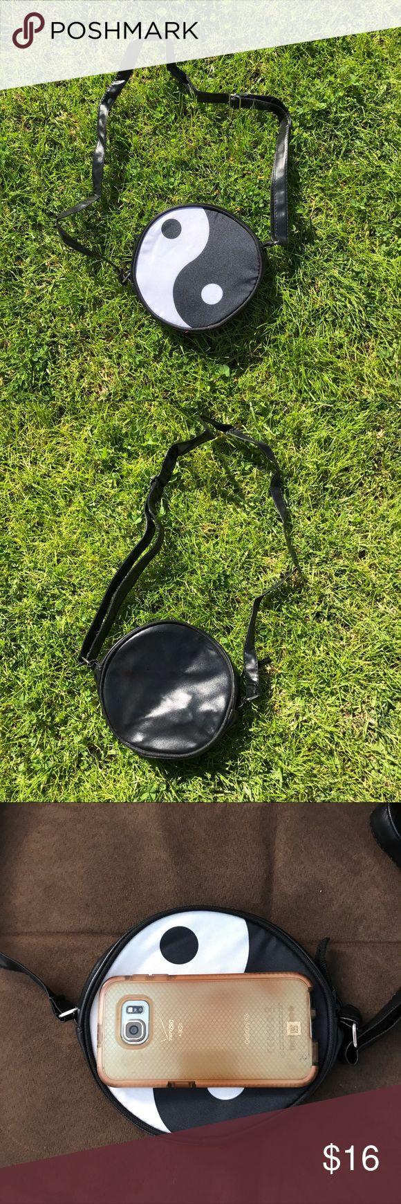 Yin Yang Circle Peace Bag Brand new, tags in original packaging. Yin Yang Peace Bag. Shoulder strap is adjustable to be longer.  Tags: festival, Coachella, beyond wonderland, lightning in a bottle, lib, rave, ravewear, dollskill, skinnydip, UNIF, harajuku, kawaii, Lolita, handbag, crossbody, topshop Bags Crossbody Bags