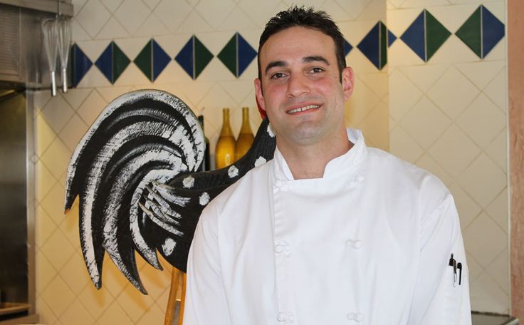 WOODEN WONDERS Chef Micah Lloyd likes burning well-aged maple wood in the wood-fired oven that is central to Caramba kitchen operations.