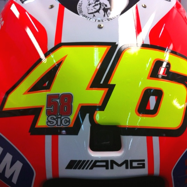 The front of Valentino Rossi's Ducati, at the 2011 season ending race, at Valencia. The race following the tragic death of Rossi's close friend, Marco Simoncelli. Stolen from Valentino's Twitter: @ValeYellow46