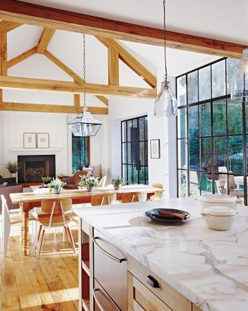 The white-oak beams and floor add both warmth and a measure of sound absorption, which are important in a big, high-ceilinged room. The beams, flooring, and hearth are all made of reclaimed wood from a barn in Minnesota.