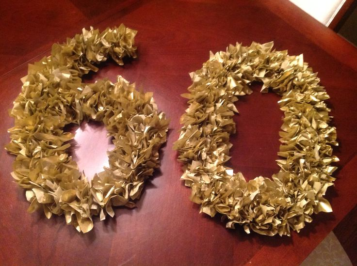 Made this for Davids 60 th  party. Very easy. Took a couple hours. Gold tissue paper cut into 4x4 squares. Foam core poster board cut 5letters with exacto knife. Glue tissue paper to the numbers. Easy project.