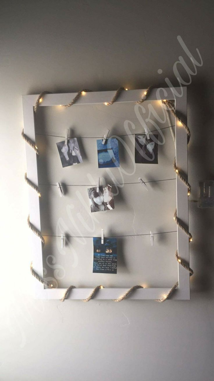 String Picture Frame You can find all of these items at your local craft store.  Frame, Rope Lights, String, nails and small clothespins.  #DIY