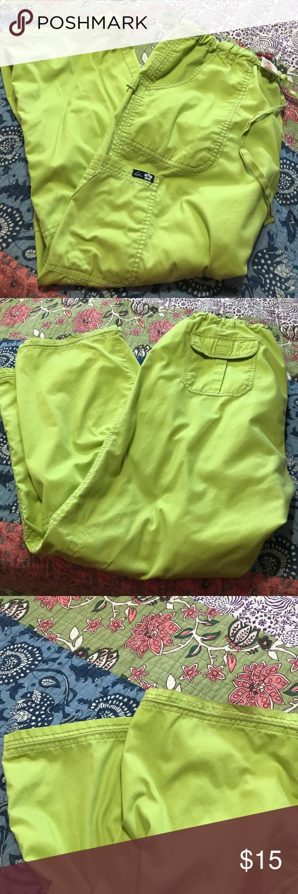 "Like new lime green koi ""Lindsay"" scrub pants 2x These great cargo scrub pants are still in amazing shape!!! As pictures very minimal damage to bottoms of legs and crotch area!!! Great scrub pants, material so soft and comfortable to work in!! koi Pants Wide Leg"