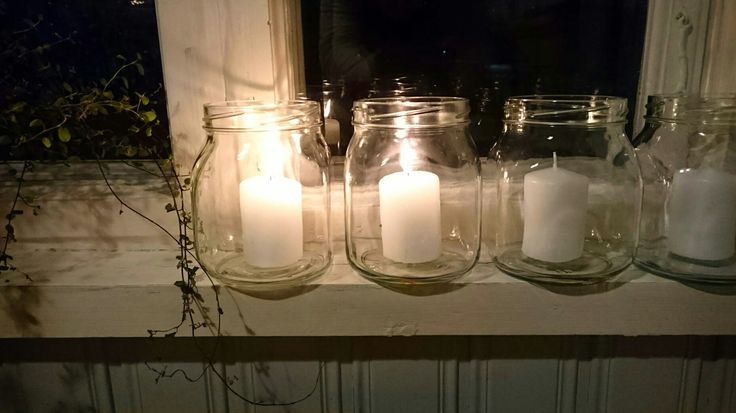 Advent candles in old recycled Finnish Ilves-tölkki glass jars on a windowsill that's almost 90 yrs old. Photo ©ninah