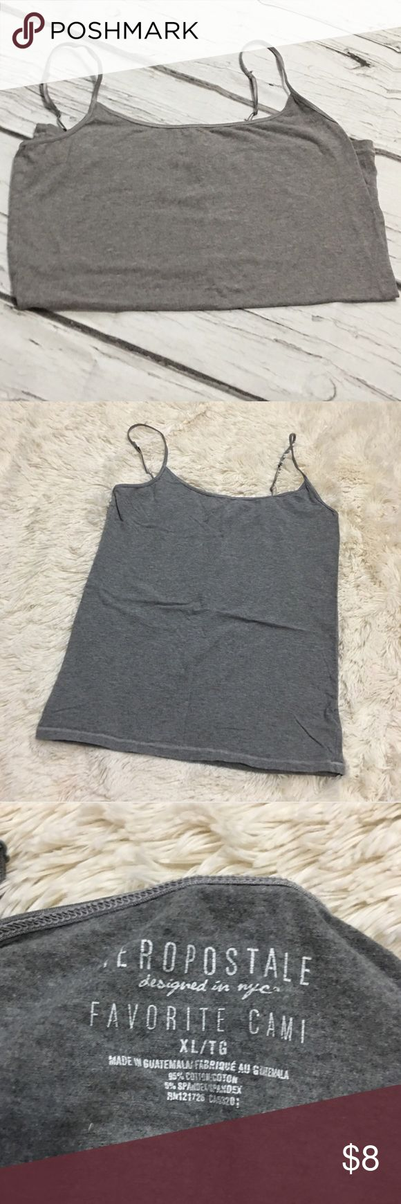 "Grey Cami Excellent used condition, worn once. No notable flaws. Aeropostale grey favorite Cami. It is 17"" from armpit to armpit laying flat and 24"" long.  Pet Friendly Home, Smoke Free Home , No trades. Offers, Bundles, and Questions Encouraged Aeropostale Tops Camisoles"
