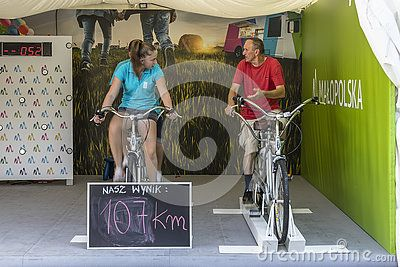Young  women and old man earn miles (kilometers) on tandem desktop.