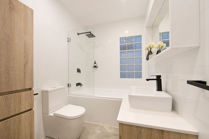 Sleek full bathroom with European laundry - 39 Marion Street Leichhardt at Pilcher Residential