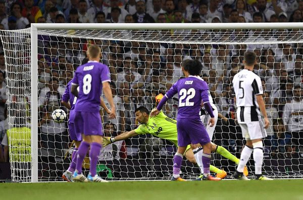 Gianluigi Buffon of Juventus dives but fails to stop Casemiro of Real Madrid (not pictured) shot from going in for Real Madrid second goal during the UEFA Champions League Final between Juventus and Real Madrid at National Stadium of Wales on June 3, 2017 in Cardiff, Wales.