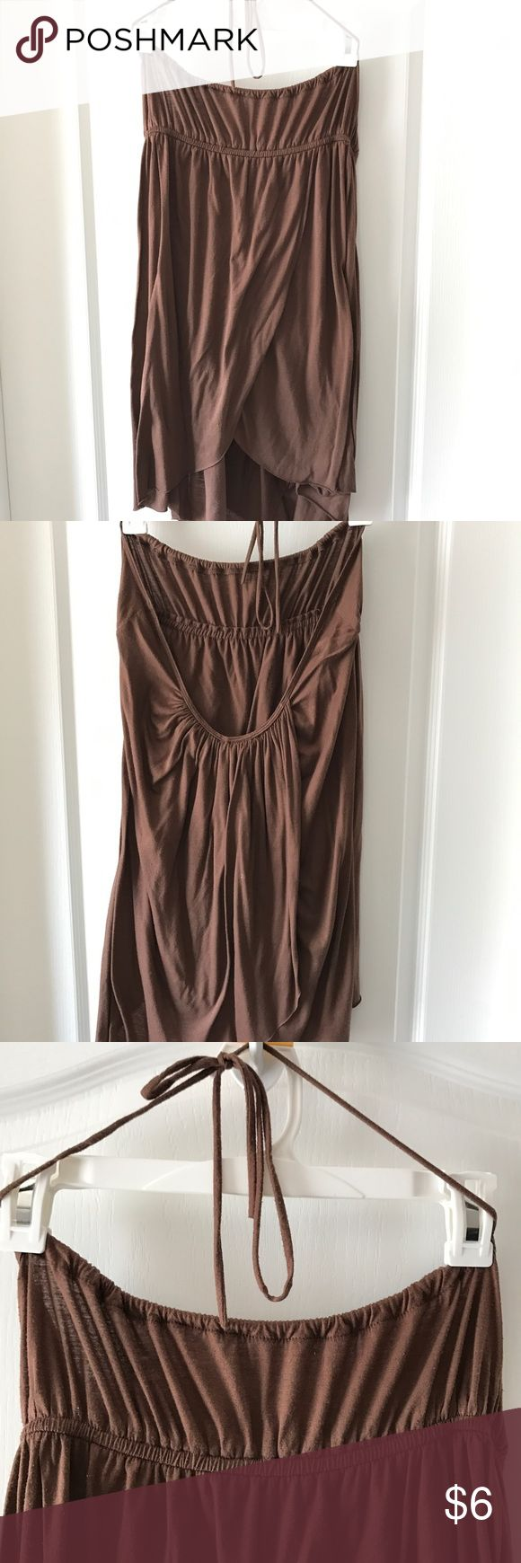 Halter style top Halter style top with low cut back, ties at neck. Versitile. Can be worn with a tank top underneath, over a bikini OR with a strapless bra. Brown; Soft cotton blend material. Forever 21 Tops Tank Tops