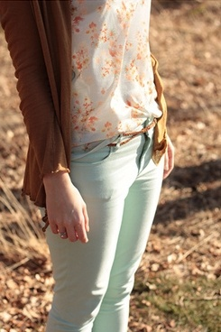 Mint jeans, floaral top with brown cover up.